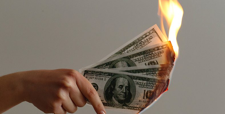 An image of money burning